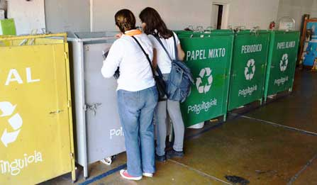 Students check out the recycling bins